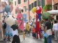 Abraxa Teatro - La Danza delle Fiere - Teatro di Strada - Teatro di Figura con trampoli